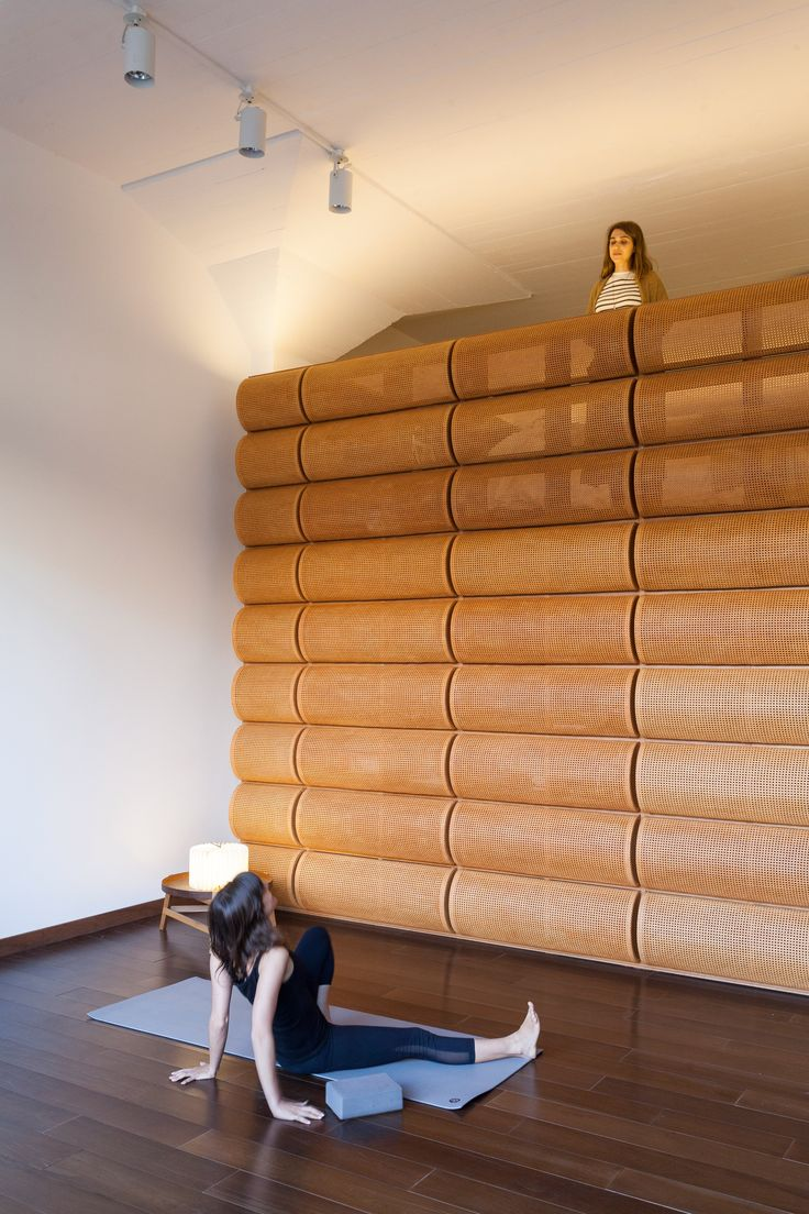 A room with wicker walls forms part of this sanctuary that Argentinian office Estudio Normal has built in the home of a Buenos Aires-based chef.