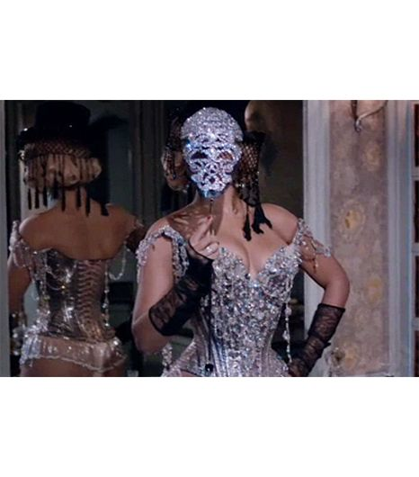 @Who What Wear - Partition                 The epic Swarovski bedazzled face mask, vintage Christian Lacroix embellished corset, and beaded Victoria Grant hat steal the spotlight in this racy video. Also worth noting: some of the epic performance lingerie is custom-made from the cabaret Le Crazy Horse in Paris.     Directed byJake Nava, styled byBea Åkerlund,with additional styling byTy Hunter&Raquel Smith