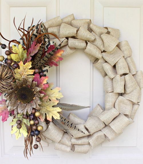 Loops and layers of burlap turn an ordinary wreath into a multi-dimensional arrangement.  Get the tutorial at Love of Family and Home.   - CountryLiving.com