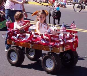 4th of July Girl in Wagon | Bend, Oregon' Annual 4th of July Pet Parade
