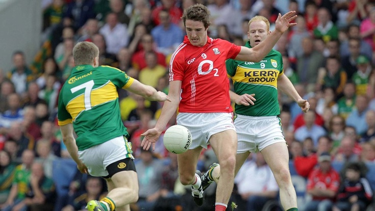 Cork's Aidan Walsh and Kerry's Peter Crowley and Seamus Scanlon
