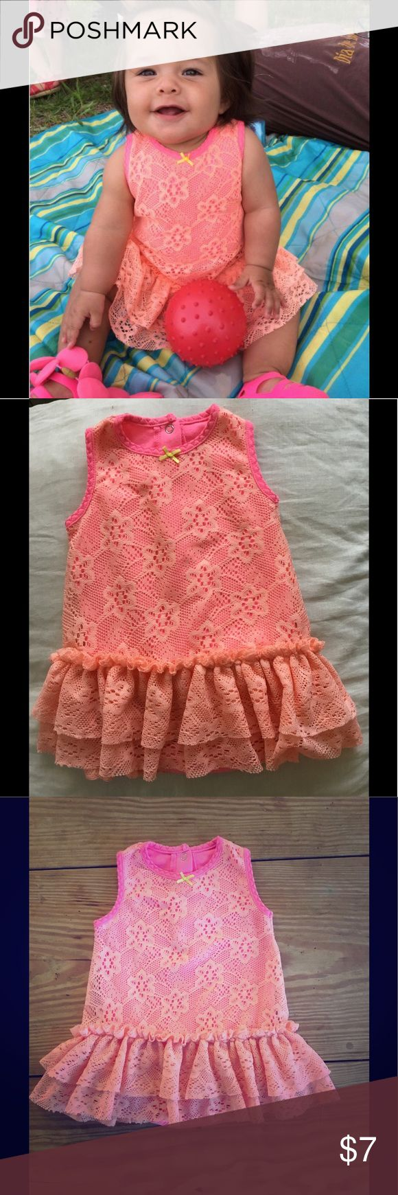 Melon lace dress overlay w/ bodysuit in neon pink Melon color lace with 2 tier ruffles at hem. Neon pink bodysuit underneath Baby Starters Dresses Casual