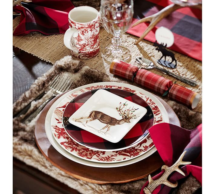 Mix patterns like buffalo check and toile to create a unique holiday place setting. Top with a cheeky reindeer salad plate and everyone sitting at the table will surely smile.
