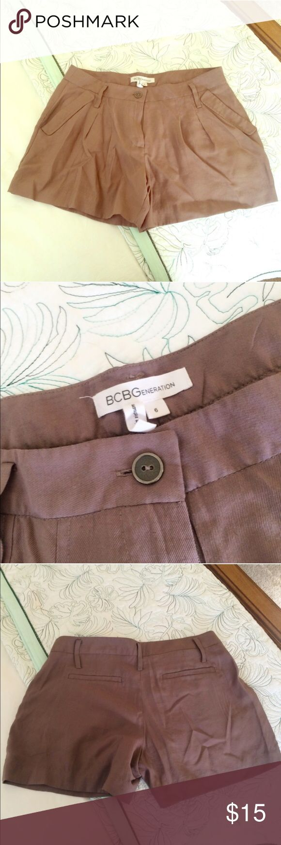 BCBGeneration Shorts Tailored BCBGeneration taupe colored shorts with front and back pockets. Run a bit on the smaller side for a 6. Excellent condition, no stains! (53% viscose, 31% lyocell, 16% nylon) BCBGeneration Shorts