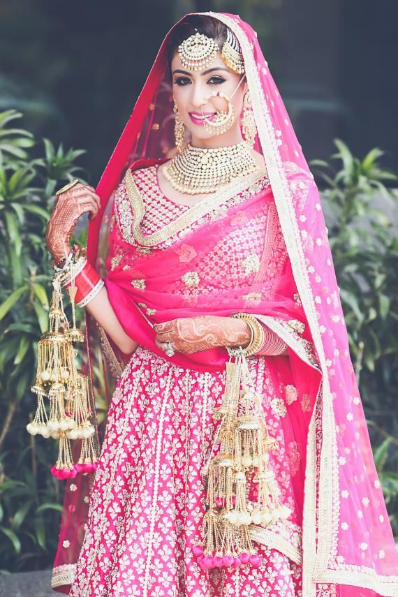 Sikh Wedding Brides - Hot Pink Anarkali with beautiful light gold work and gold kaleere | WedMeGood  #wedmegood #sikh #brides