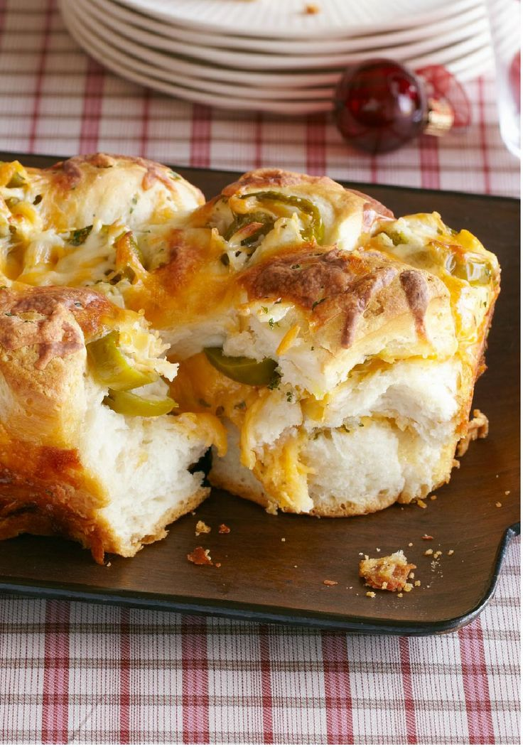 Jalapeno & Cheese Monkey Bread -- Shredded pepper Jack cheese and pickled jalapeno nacho slices are layered between pieces of refrigerated biscuits to make this flavorful monkey bread recipe.