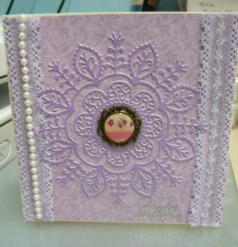 Tattered Lace Anne die features in the middle of this card. Adding lilac lace ,pearls, and embellishment