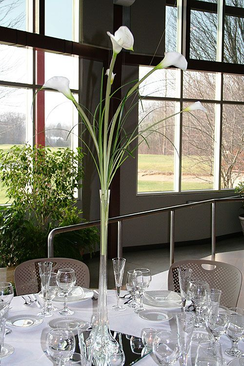 calla lillies centerpieces | Mini white life-like Calla Lily's accompanied by wisps of live lily ...