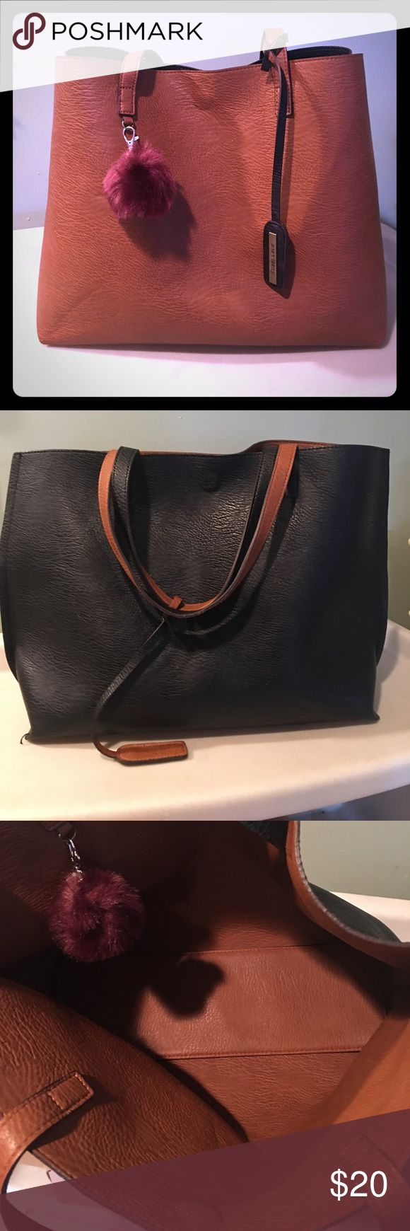 👜American Eagle Tote👜 American Eagle Tote Bag.. love this bag just haven't used it in months! Leather material so it's easy to clean.  Reversible.. so it can be black or brown! Super cute!! American Eagle Outfitters Bags Totes
