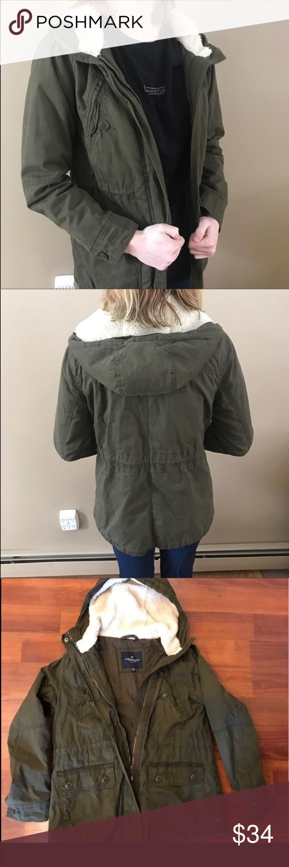 AMERICAN EAGLE OUTFITTERS ARMY GREEN COAT/JACKET Army green with a white Sherpa hoodie. Model is 5'6 and wears a small American Eagle Outfitters Jackets & Coats