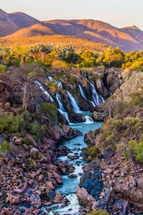 Epupa falls, Namibia. Click theculturetrip.co... for everything a traveler needs to know about a trip to Namibia.