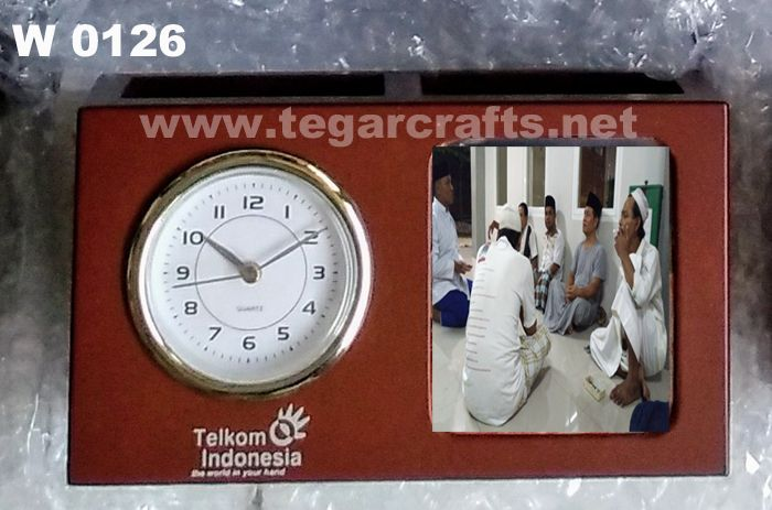 W0126: A triple function in one stuff wooden merchandise, a deskclock, penholder and photoframe, with print logo ordered by PT Telkom Indonesia, Jakarta Indonesia.