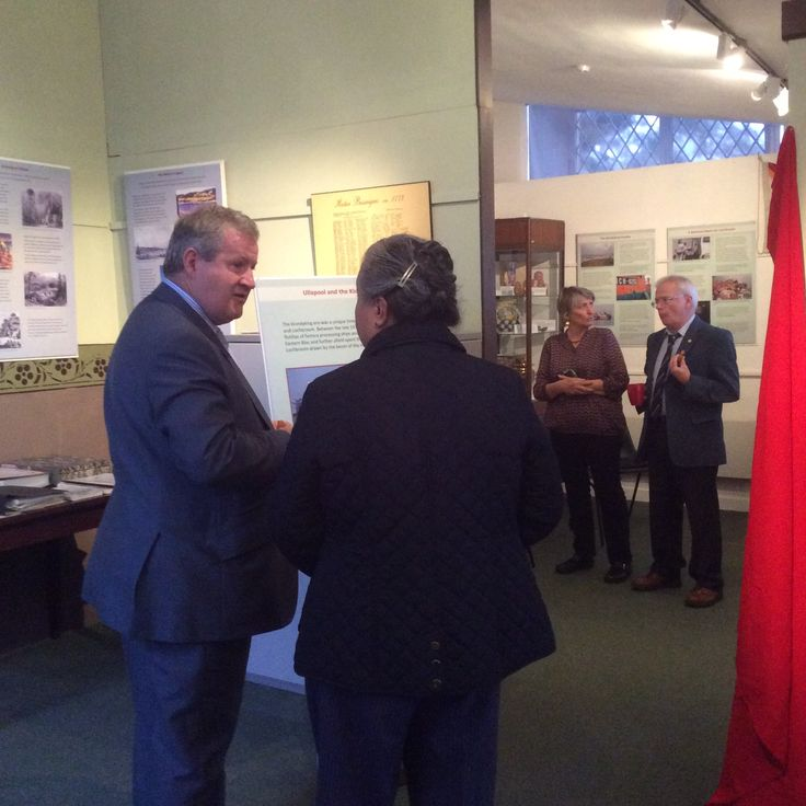 Discussing the work done by volunteers in putting the exhibition together