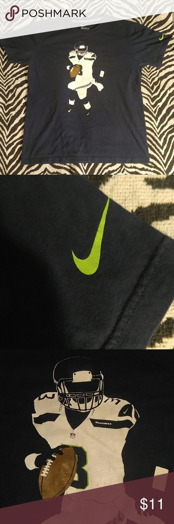 Nike Seattle Seahawks Russell Wilson player tee L Awesome Nike tee featuring a graphic of Super Bowl winning Seahawks QB Russell Wilson. Item has some very light fade and super light cracking to logo but overall in great shape. Super comfy and functional, a must have for any fan! Nike Shirts Tees - Short Sleeve
