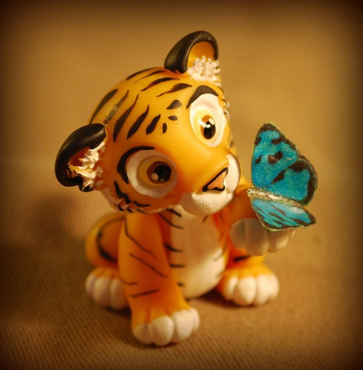 Little tiger and butterfly by melinaminotti on DeviantArt