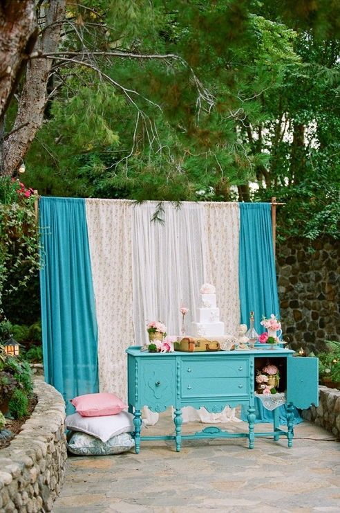 Curtains set up for photo booth. by kay