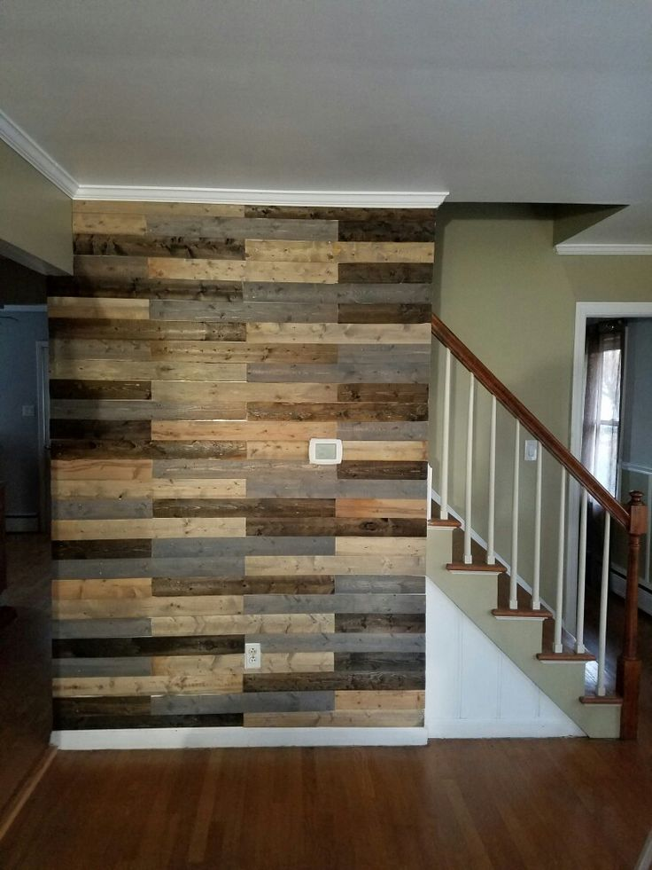weekend DIY project.... wood plank accent wall. we used old wood fencing, and stained them 3 different colors. $16 later, here we are. love the finished  product!