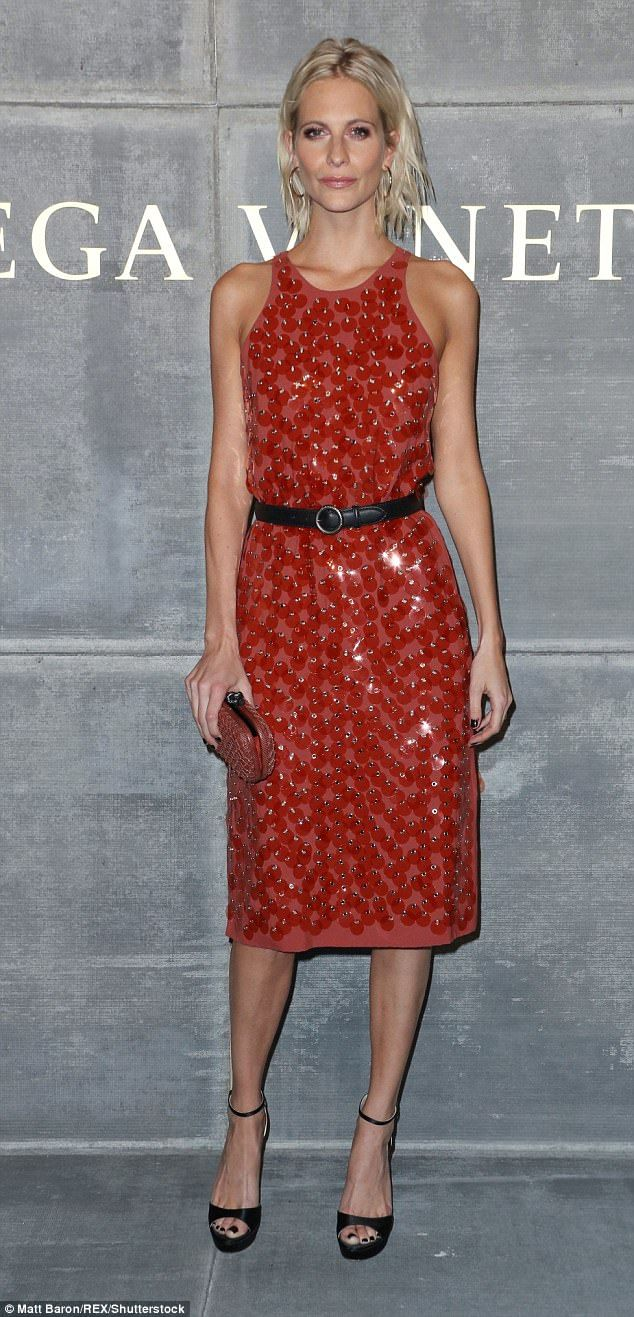 Work it: Poppy Delevingne, 31, was back to her old style tricks on Friday night as she showcased her slender frame in a vibrant midi dress for the Bottega Veneta AW18 show during New York Fashion Week