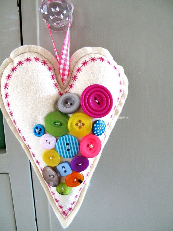 Lots of cute button ornaments   Christmas Decoration Bright Buttony Hanging Heart. £8.90, via Etsy.