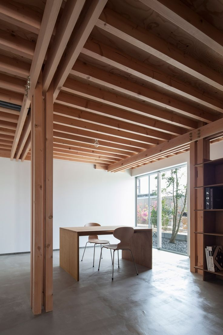 This Tokyo house features four wooden columns arranged in a square to support the rest of the timber frame.