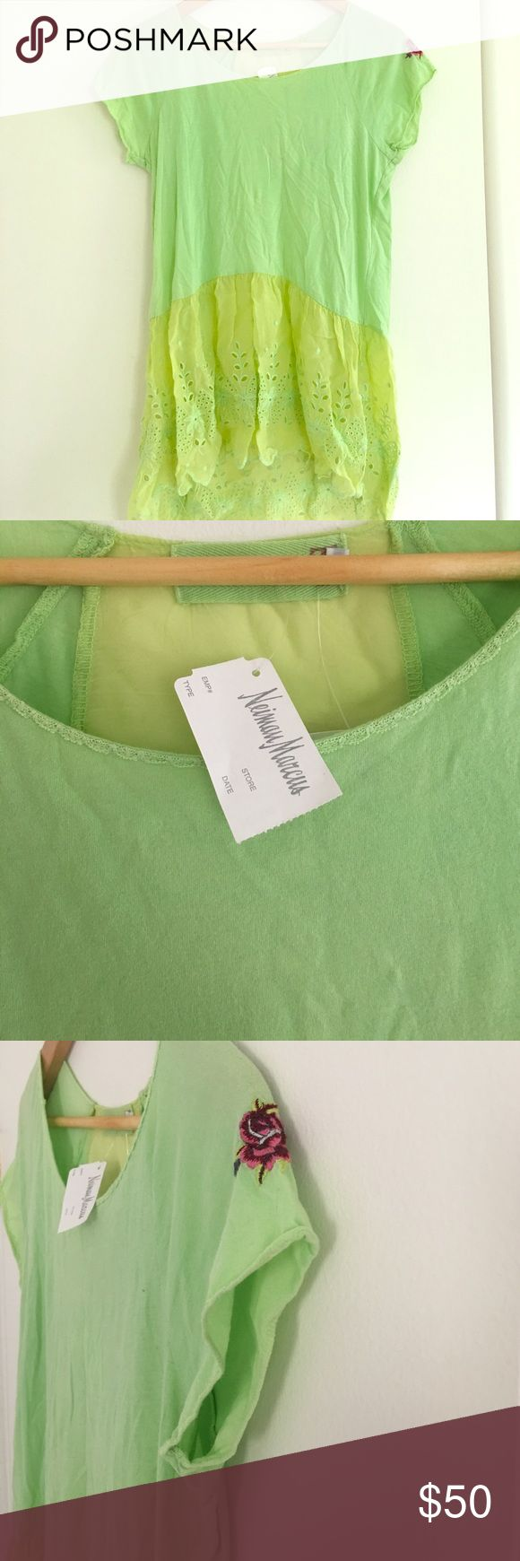 Neiman Marcus Green Tunic Glory Green tunic with lace bottom and sheer section in the back cute flower detail on the left shoulder Neiman Marcus Tops Tunics