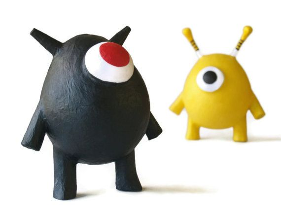 One-eyed monsters made from paper maché.