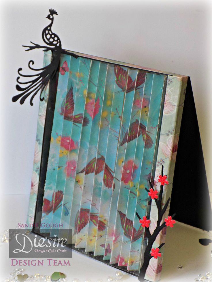 Sandie Gough: Tent Fold Illusion Frame - Kimono Paper Pad - Die'sire Kimono die sets: Peacock & Lotus Branch - Crafter's Companion Matt Black card, Kraft card & Acetate - Collal All Purpose & Tacky glues - #crafterscompanion