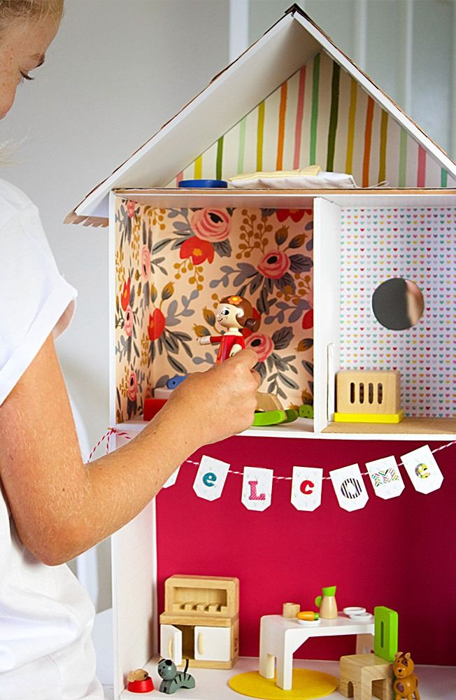 This DIY dollhouse tutorial will provide hours of imagination and creativity! Learn how to create this beautiful keepsake in no time. Your kids can even help with the makeover by coming up with ideas for the interior and exterior, including the wallpaper, flooring, kitchen and don't forget an adorable bookcase!