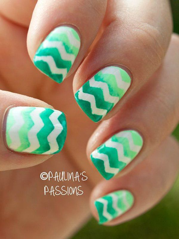 Green is definitely a color to be in when it comes to summer. This unique and fun looking nail design looks just like you have cool and crazy watermelon nails. Coated with sea green and forest green shades, the nails are then painted with white zigzag lines which make the overall ensemble more fun and engaging to look at.