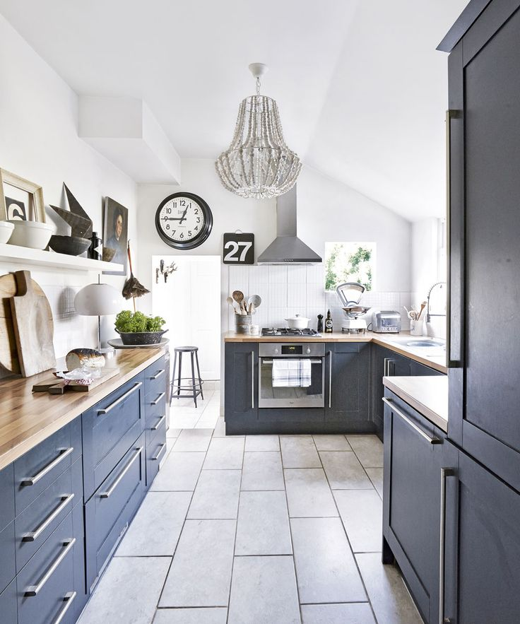 Dark-grey-traditional-kitchen-with-tiled-floor-and-chandelier