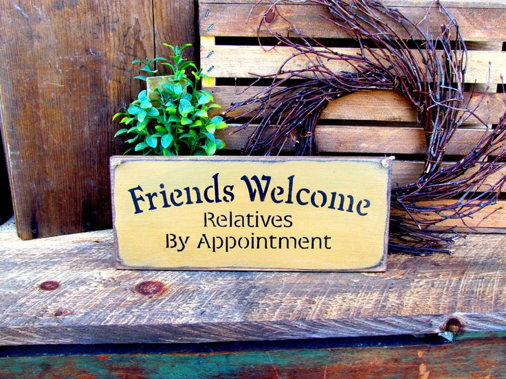 """This wooden sign is made from pine, and measures 5.5""""W x 13""""L. It reads """"Friends Welcome Relatives by Appointment"""". The front is painted mustard yellow, sanded then distressed. The back is stained and"""
