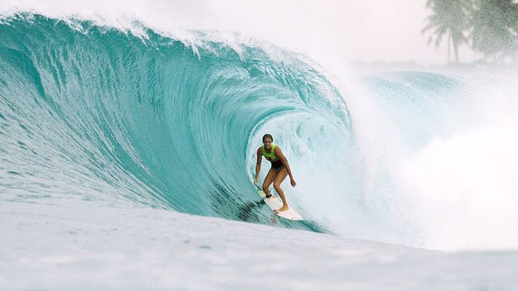 Transport yourself from your office desk - to a balmy day in Indo.   Watch Stephanie Gilmore surf warm water waves to warm you up in these icy days.