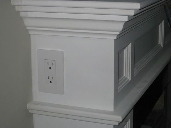 neat idea - electrical outlet on side of fireplace mantle - courtesy of ths.gardenweb.com