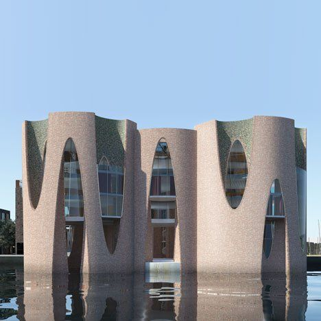 Artist Olafur Eliasson has designed fort-like headquarters to rise out of the sea for a Danish investment company. Located in the harbour-side town of Vejle, the building will have a curved brick facade with sliced oval recesses. It will be accessed from the marina via a new footbridge. Kirk Kapital A/S's offices will occupy the upper