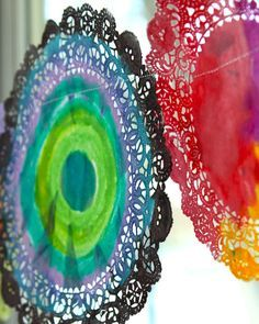 """watercolor doilies - perfect school room window """"shades"""" or sew together as she did to make a garland."""