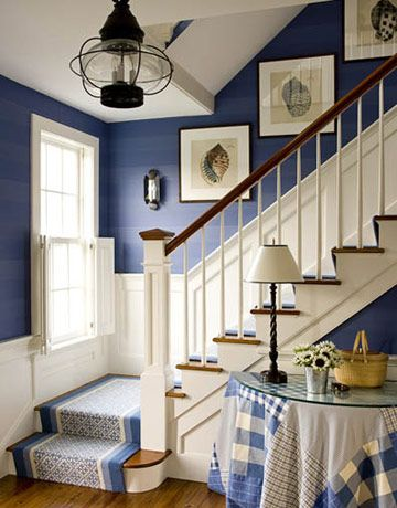 Deep blue with white wainscoting, light fixture.... Like a old lantern. Would prefer different table cloth