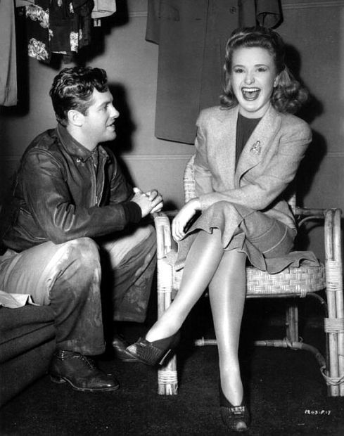Robert Cummings elicts a good laugh from his Saboteur costar Priscilla Lane