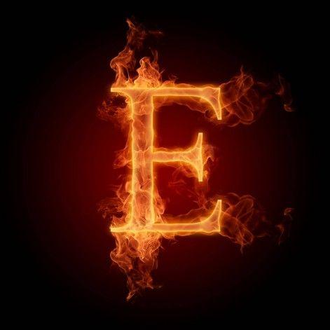 Burning Letter E On Black Background