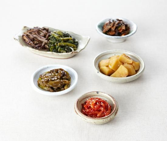 "Wiki: Korean Banchan (panch'an):  반찬;  飯饌;  ""rice/food  & sidedish""; Small dishes of food served w/basic meal (bansang 반상) of: bap (밥 rice), guk or tang (soup), gochujang or ganjang, jjigae, & kimchi. Added banchan (3 cheop to 12 cheop (royal cuisine) bansang) are set in the middle of the table to be shared. At the center of the table is the secondary main course, such as galbi or bulgogi. Banchan are to be finished at each meal - but replenished if not enough. - Wikipedia"