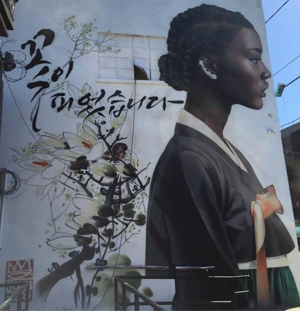 Korean graffiti artist celebrates Black women's power and beauty in mural series