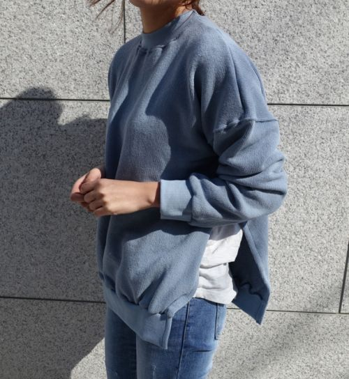 white shirt under light blue sweater with slits on the sides