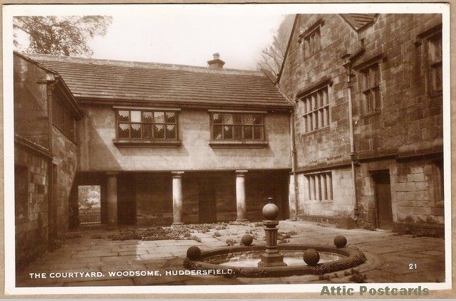 Vintage real photo postcard of the courtyard of Woodsome Hall in Kirkburton, Huddersfield, in Yorkshire, England. This is home to the Woodsome Hall Golf Club.