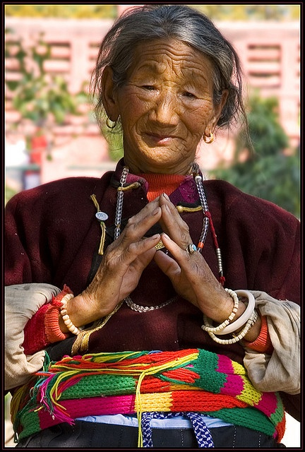 Pray for Tibet, Bodh Gaya by Elishams ~ She kept praying and praying all morning facing the Mahbodhi temple, near the tree under which Buddha got illumination. I asked her for a photo, she gave me a wonderful smile, so cute. By the time I framed she was back in her pray(er).