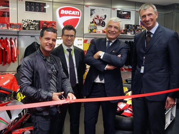 Ducati opens new shop at the Marco Polo Airport in Venice, In the image , Ducati Shop at Venice Airport ribbon cuutting ceremony, Lucio Attinà (Director, BU Apparel & Brand Development, Ducati), Andrea Geretto (Director, Commercial and Marketing, Non Aviation, Marco Polo Airport, Venice), Gabriele Del Torchio (CEO, Ducati) and Marco Passoni (CEO, Meridian Duty Free).
