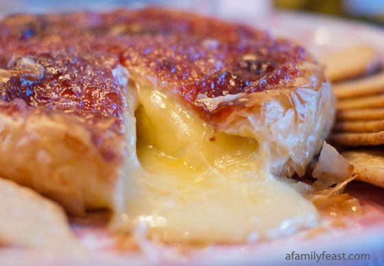 Baked Brie...  Top with preserves, then wrap in phyllo dough & brush with butta.  YUM.