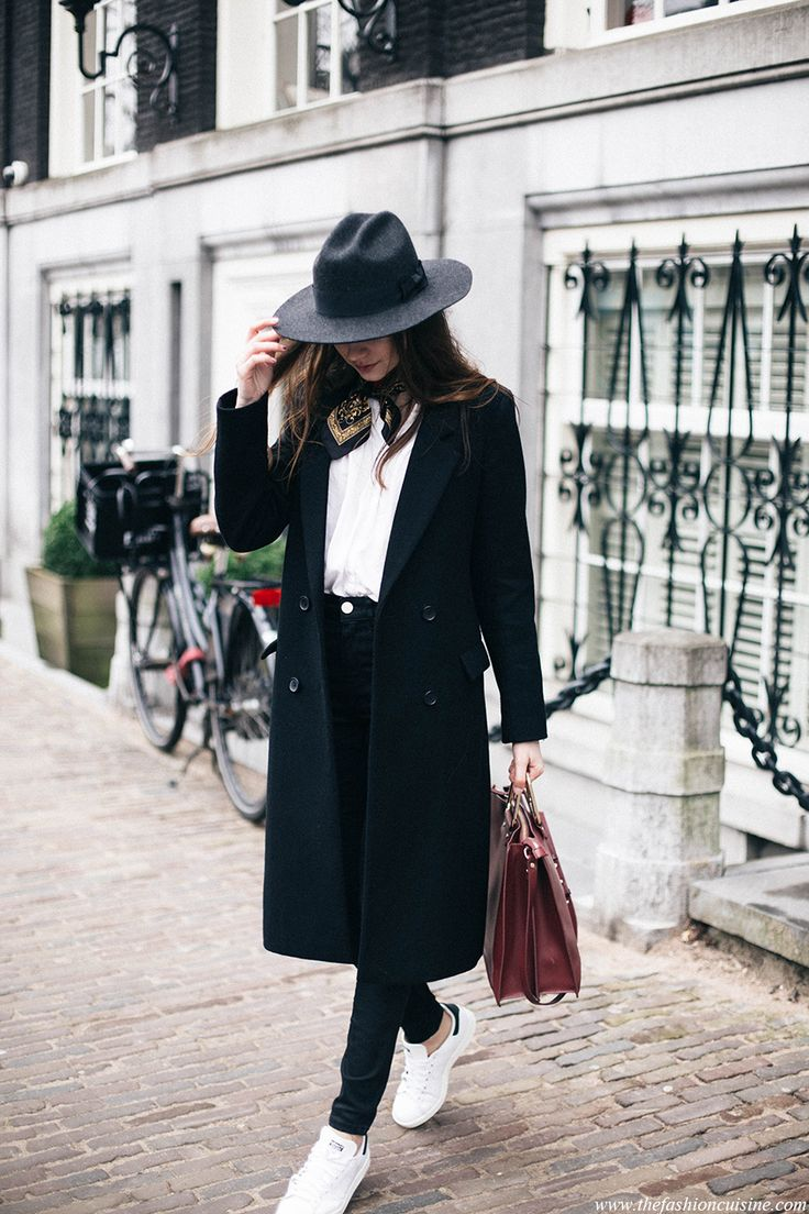 structured coat and hat with skinny jeans and sneakers