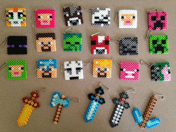15 mixed keychains or necklaces, swords, pick axe, stampy cat