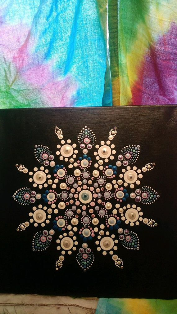 Just in time for winter! This 12 by 12 canvas utilizes the mandala dot technique to create a gorgeous snowflake, complete with Swarovski crystals. Made with lots of LOVE for you to enjoy