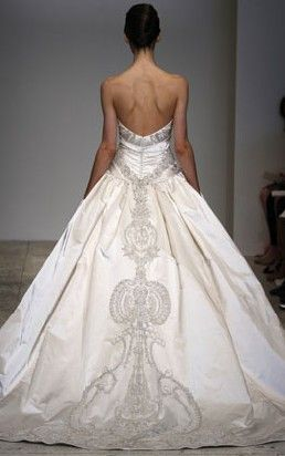 the back. Royal Duchess Satin. Satin strapless ballgown with ruched bodice, crystal beaded sash and train.