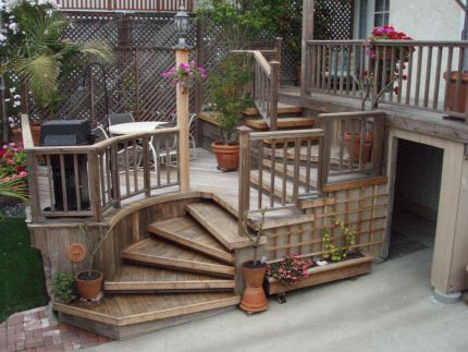 possible side deck solution!  redwood curved stairs.